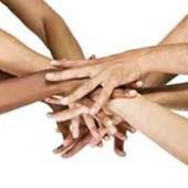 A huddle of people's hands